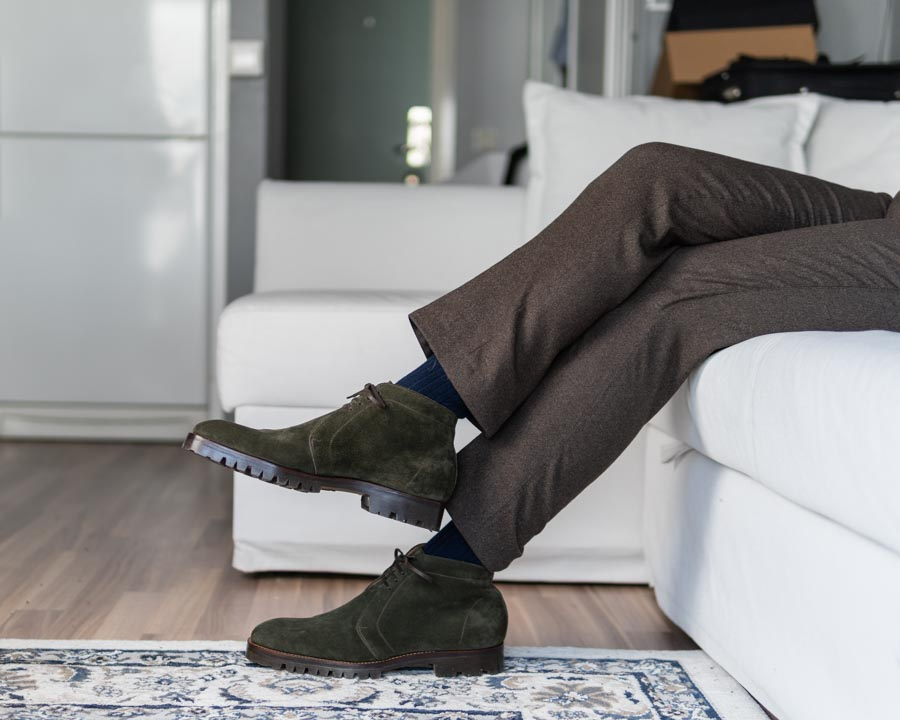 brown flannel trousers and green chukkas